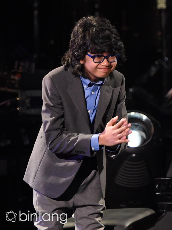Joey Alexander ketika tampil di Grammy Awards 2016. (AFP/Bintang.com)
