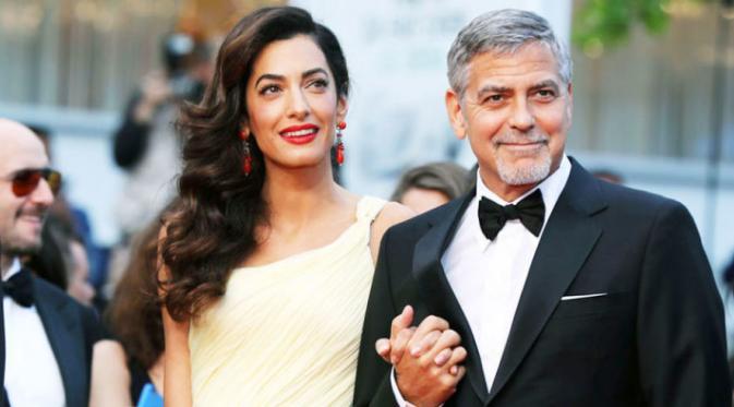 Amal Clooney tampil memikat di karpet merah Cannes Film Festival.