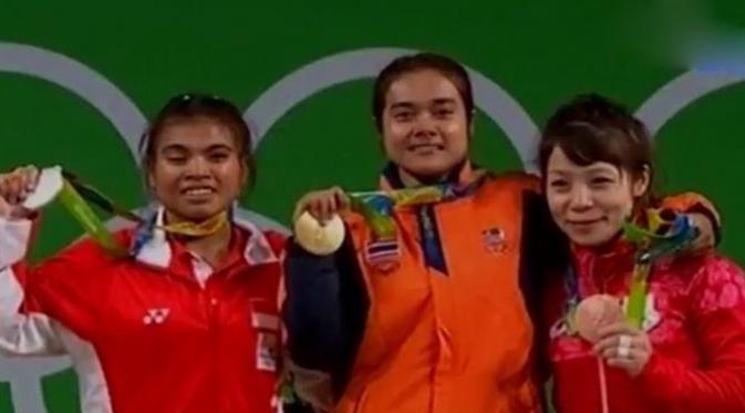 Sri Wahyuni usai mendapatkan medali perak di Olimpiade Rio de Janeiro, Brasil 2016.